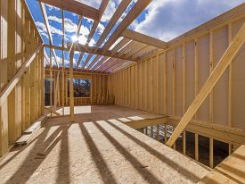 pic of 2x4  - New framing house construction with no roof and two by fours exposed - JPG
