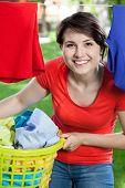 Happy Woman Doing Housework Outside