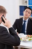 Two Businessmen Having A Lunch Time