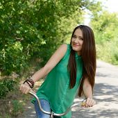 Happy smiling young beautiful woman with retro bicycle, summer outdoor