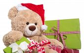 Teddy Bear Wearing Christmas Hat With Gifts On White Background