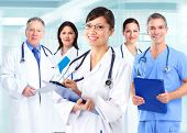 Group of medical doctors over blue hospital background