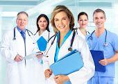 Medical doctors team over blue hospital background