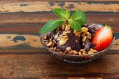 Acai Pulp In Glass With Strawberry, Muesli And Fresh Mint On Wooden Table