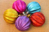 Christmas decorations balls on background sacks