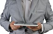 Businessman Holding A Tablet Touch Computer Gadget