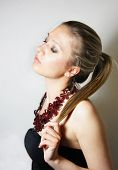 Young Beautiful Woman In Luxury Necklace