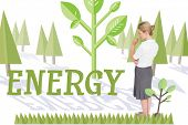 The word energy and thinking businesswoman against forest with trees