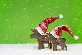 Two Wooden Reindeer: Funny Green And White Christmas Background.
