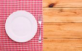 foto of recipe card  - Cutlery on red checkered tablecloth tartan on a wooden table top view - JPG