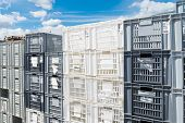 foto of picking tray  - piled up empty plastic crates on an industrial area - JPG