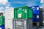 picture of picking tray  - piled up empty plastic crates on an industrial area - JPG