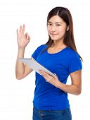 Asian woman with digital tablet and ok sign