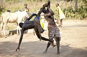 BOR, SOUTH SUDAN-DECEMBER 4 2010: Unidentified South Sudanese wrestlers compete in tribal wrestling.