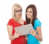 Two Young Isolated Woman Looking At Tablet-pc: Concept For Dating.