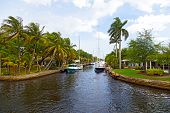 Motorboats moored along the canal in suburb of Miami Florida.