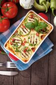 Moussaka dish with zucchini, eggplant and chili pepper, traditional greek food