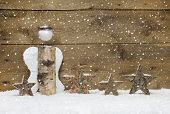 Christmas: Angel And Wooden Stars With Snowflake Design On Wooden Background - Handmade Idea