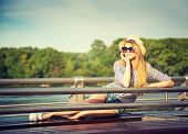 Portrait of Young Hipster Woman Relaxing in Park