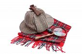 stock photo of sherlock holmes  - Deerhunter or Sherlock Holmes cap cap magnifying glass tartan scarves Isolated on white - JPG