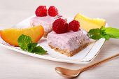 Cake with fruits and berries on plate on wooden background