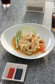 stock photo of green papaya salad  - green papaya salad in white dish on the foods table - JPG