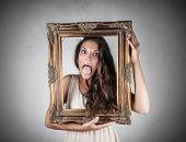 girl holding a frame
