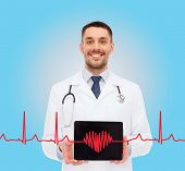 medicine, profession, and healthcare concept - smiling male doctor with tablet pc computer