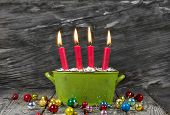 Four Red Christmas Candles - Traditonel In Green And Red - Decoration Advent On A Old Wooden Backgro