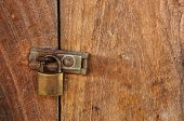 Padlock With Wood Background