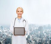 healthcare, technology, advertisement and medicine concept - smiling female doctor with stethoscope