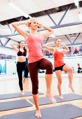 fitness, sport, training, gym and lifestyle concept - group of smiling female with trainer exercisin