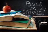 School Supplies Against Blackboard.