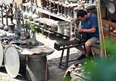 SAFRANBOLU, TURKEY - JUNE 24, 2012: Artisan works in his street workshop. Handicraft shops are very