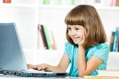 Little girl using laptop