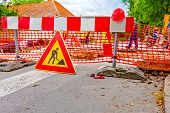 foto of reconstruction  - Road signs in a street under reconstruction symbol - JPG