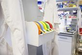 Rolls of multicolored labeling tape in laboratory