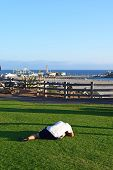 stock photo of sm  - A man stretching and doing Yoga in a park - JPG