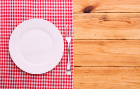 pic of recipe card  - Cutlery on red checkered tablecloth tartan on a wooden table top view - JPG
