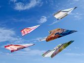 Swiss Franc banknotes as toy planes rising high in the sky