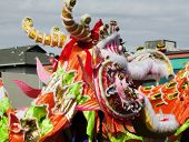 stock photo of dragon head  - Colorful Chinese Dragon Head Profile Outdoors Parade - JPG