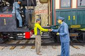 MOLLENDO, PERU, MAY 19, 2014:  Tourist shakes hands with a wax statue of rail worker in Ferro Carilles del Sur train open air museum