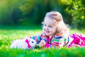 Little Girl And Real Rabbit