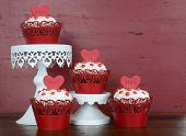 Happy Valentine Red Velvet Cupcakes With Love Messages On Red Vintage Wood Background.