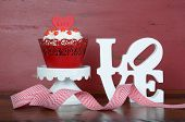 stock photo of red velvet cake  - Happy Valentine red velvet cupcakes with love messages on red vintage wood background with love sign - JPG
