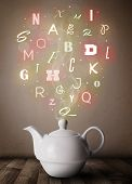 Tea pot with colorful letters, close up