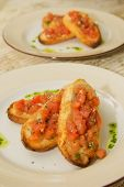 toast with red fish on a plate
