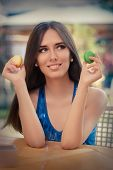 Girl Choosing Between Macarons Flavors