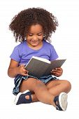 image of girl reading book  - Student little girl reading with a book isolated over white - JPG