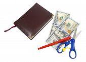 Notebook, Pen, Scissors And Dollars